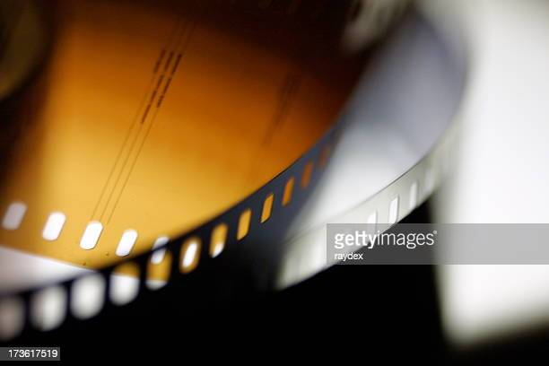 A closeup of black and yellow movie or photo film