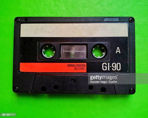 Close-Up Of Black Audio Cassette On Green Table
