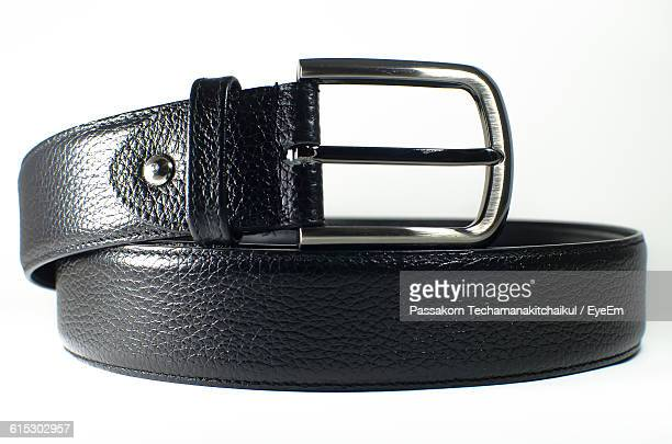 Close-Up Of Black Belt Against White Background