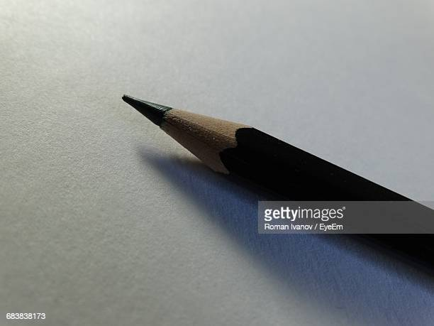 Close-Up Of Black Pencil On Table