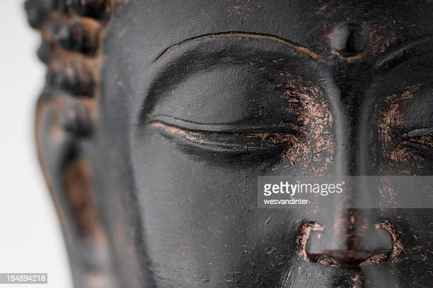 Closeup of black stone Buddha face