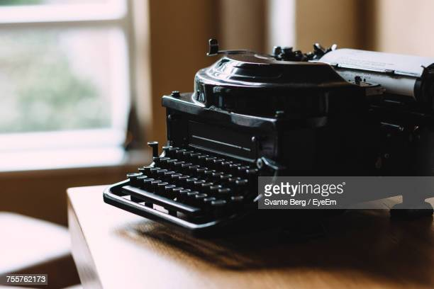 Close-Up Of Black Vintage Typewriter On Wooden Table
