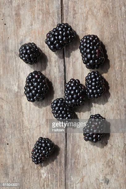 Close-up of blackberries on wooded table