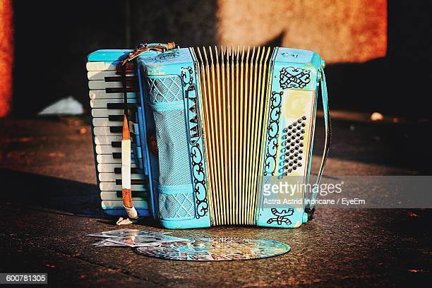 Close-Up Of Blue Accordion On Floor