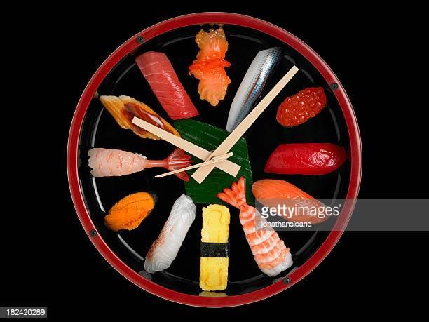 Uhr mit sushi-Stücke für Telefonnummern