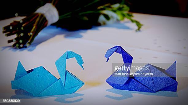 Close-Up Of Blue Bird Origami On Table