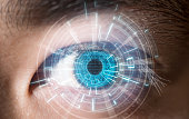 Close-up of blue eye digital scanning technology concept in future