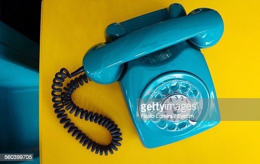 Close-Up Of Blue Retro Telephone On Table