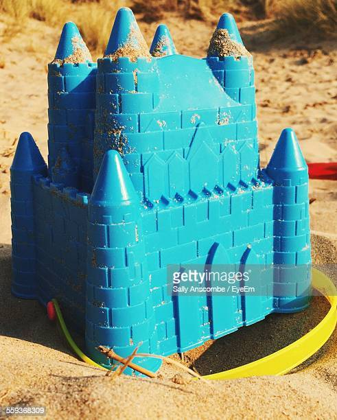 Close-Up Of Blue Sandcastle Bucket In Sand Of Ainsdale Beach