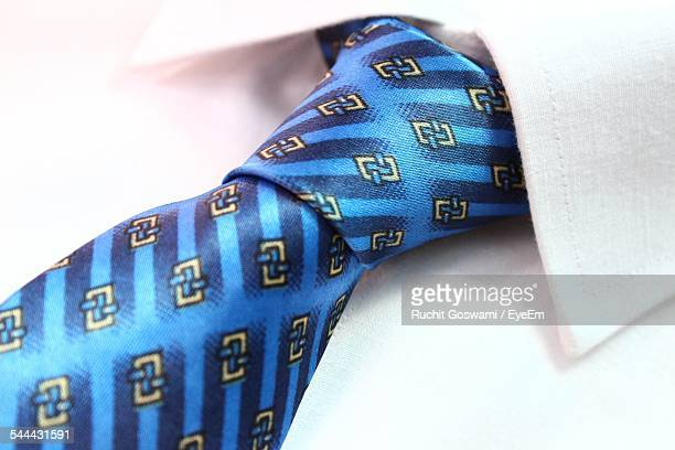 Close-Up Of Blue Tie On White Shirt