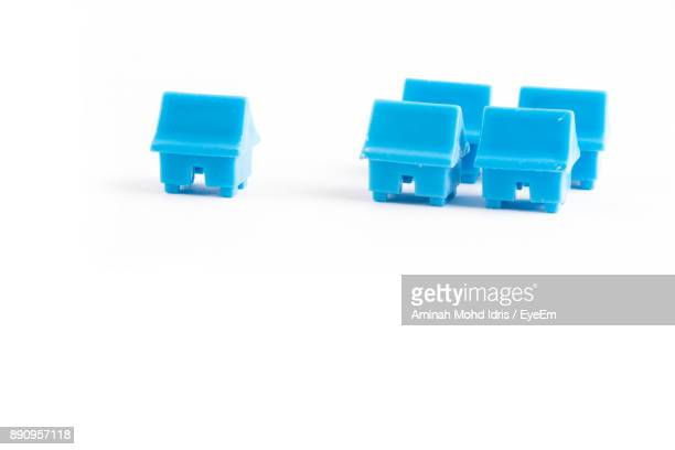 Close-Up Of Blue Toy Houses Over White Background