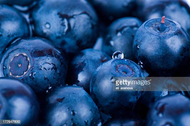 Closeup of blueberries piled together