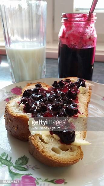 Close-Up Of Blueberry Jam On Bread Served On Plate
