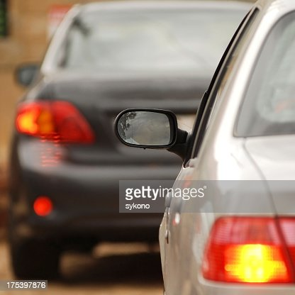 Close-up of blurred and on focus cars in traffic jam