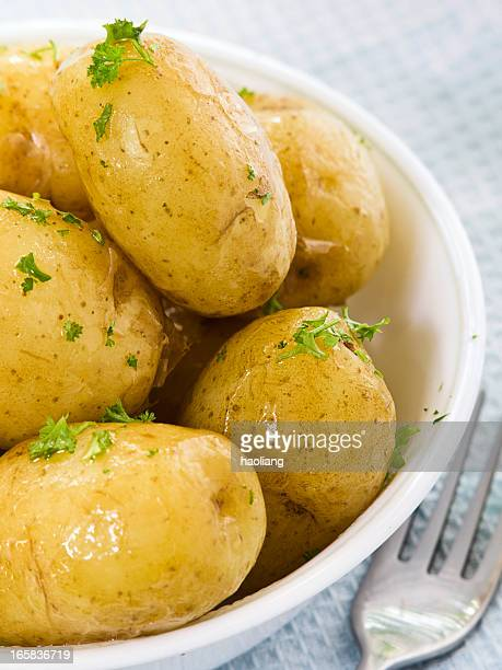 Close-up of boiled potatoes in a bowl with herbs
