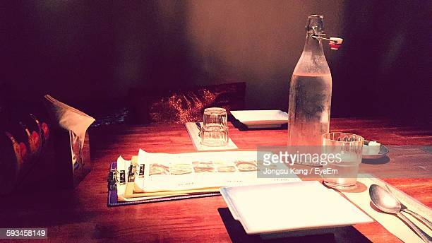 Close-Up Of Bottle And Paper On Table