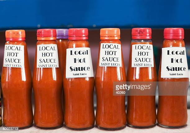 Close-up of bottles of sauce in a row