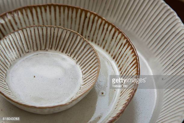 Close-up of bowl and plates
