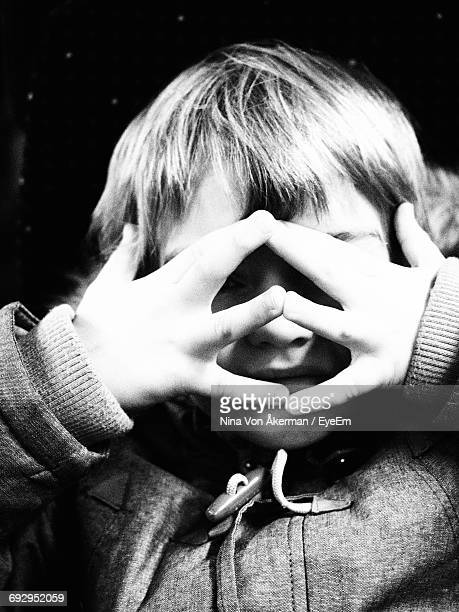 Close-Up Of Boy Covering His Face With Hands