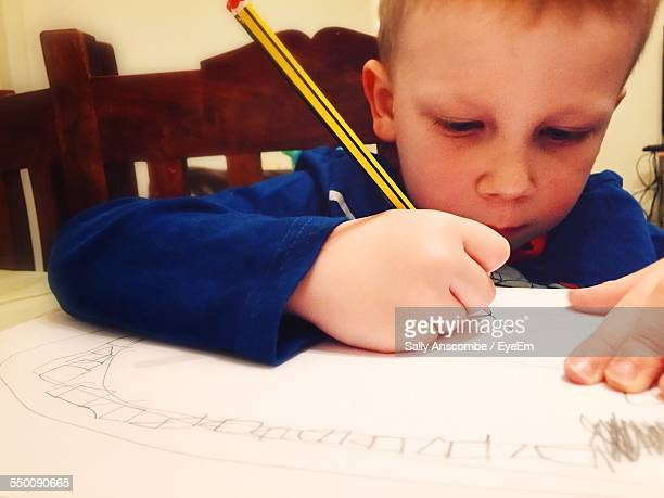 Close-Up Of Boy Drawing On Paper