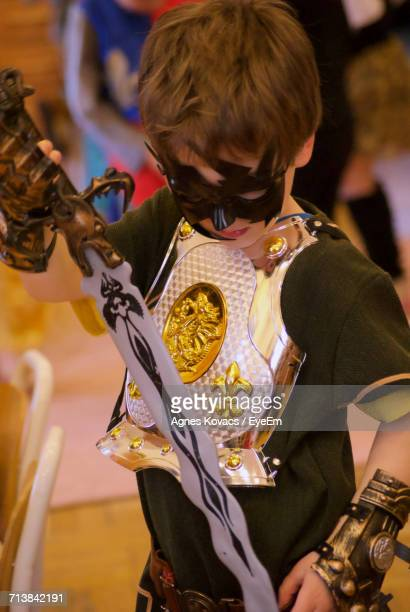 Close-Up Of Boy In Knight Costume During Party