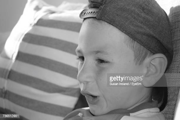 Close-Up Of Boy Looking Away While Making Face At Home