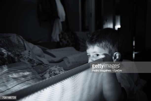 Close-Up Of Boy Relaxing On Bed At Home
