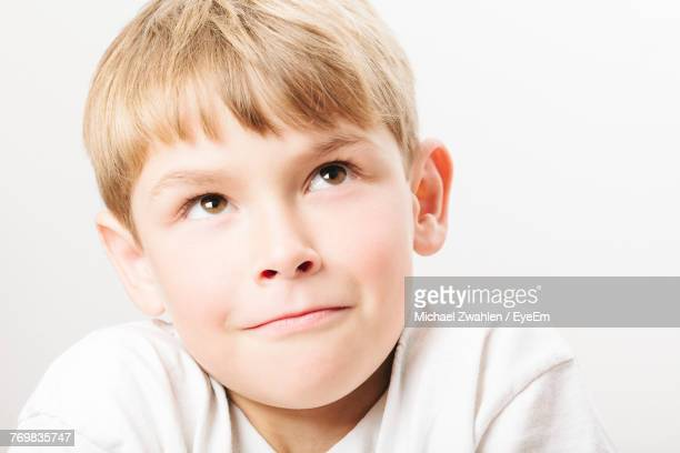 Close-Up Of Boy Smiling Against White Background