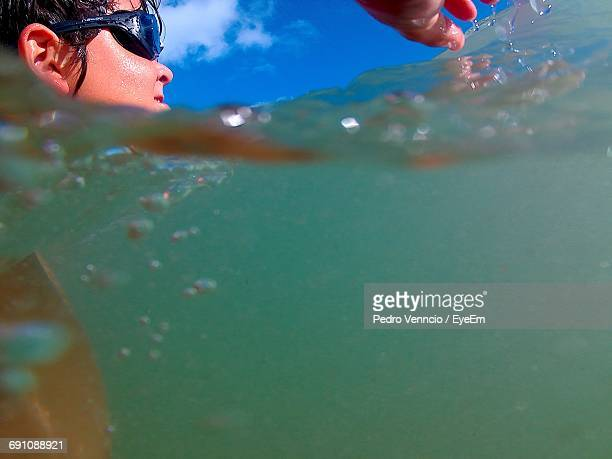 Close-Up Of Boy Wearing Swimming Goggles In Sea
