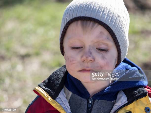 Close-Up Of Boy With Soot Smear On Face