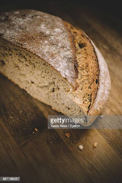 Close-Up Of Bread Slice On Wooden Table