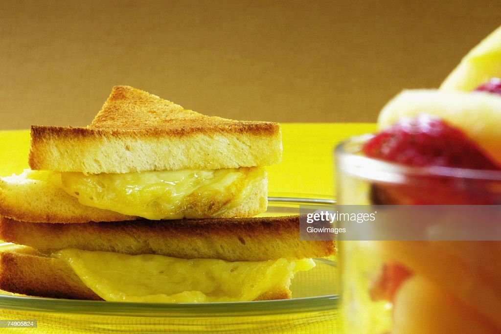 Close-up of bread with a bowl of fruit salad : Stock Photo