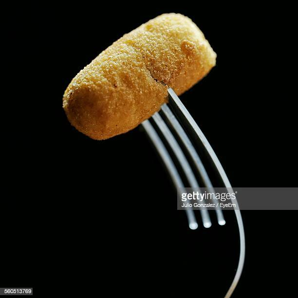Close-Up Of Breaded Croquette With Fork