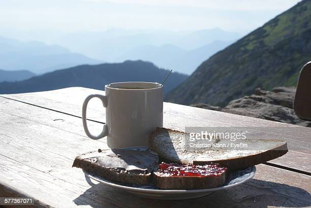 Close-Up Of Breakfast On Table Against Mountains