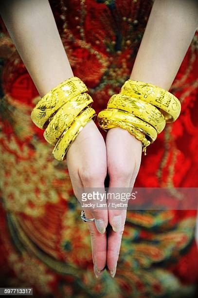 Close-Up Of Bride Hand Wearing Gold Bangles
