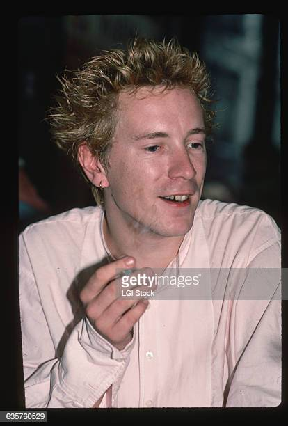 1984 A closeup of British musician John Lydon of the band Public Image Ltd He is talking smoking a cigarette and wears a pink suit Lydon is also...