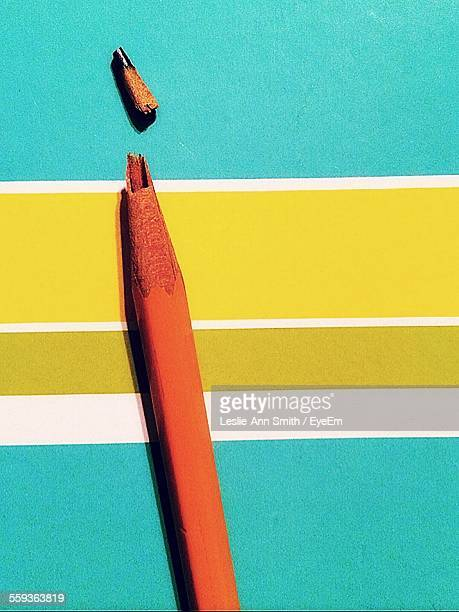 Close-Up Of Broken Pencil On Table