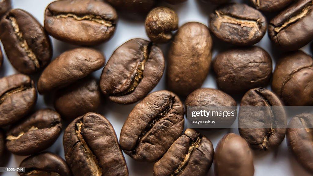 ブラウンのコーヒーの背景のクローズアップ : ストックフォト