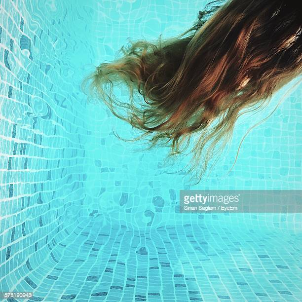 Close-Up Of Brown Long Hair In Swimming Pool