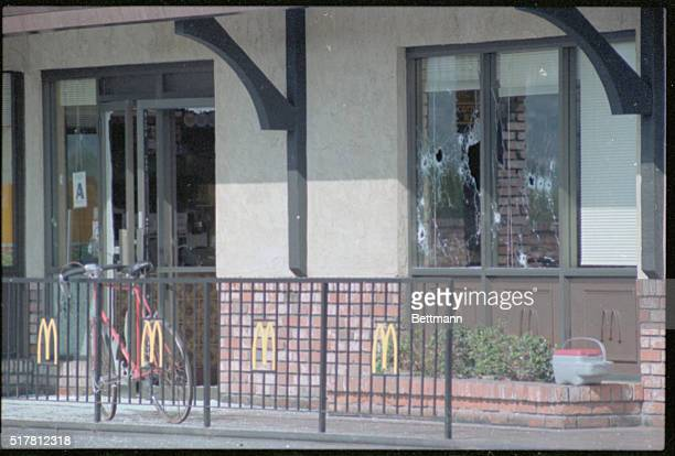 A closeup of bullet hole ridden windows from the McDonald's Massacre in San Ysidro California when a man by the name of James Huberty mercilessly...