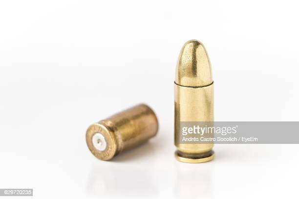 Close-Up Of Bullets On White Background