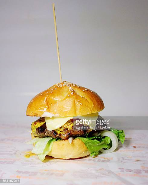 Close-Up Of Burger Against Wall