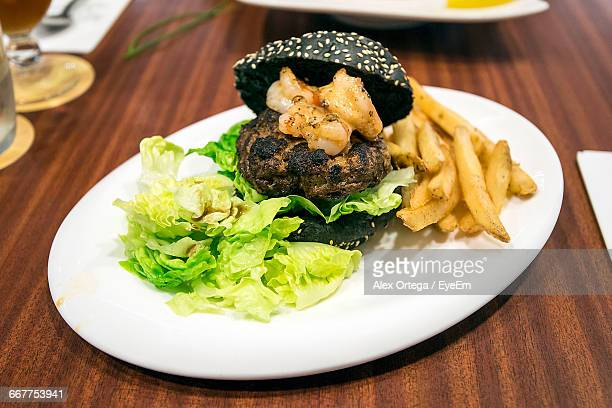 Close-Up Of Burger Served In Plate On Table