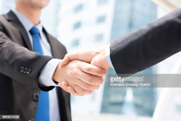 Close-Up Of Business Doing Handshake Outdoors