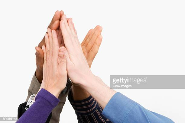 Close-up of business people's hand giving high-five