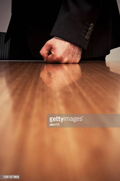 Close-up of Businessman Hitting Desk with Fist