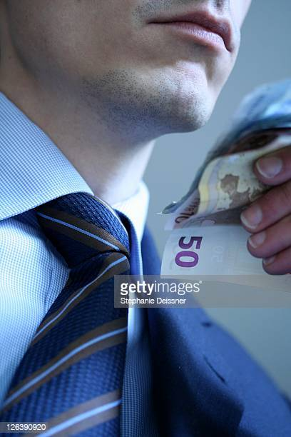 Close-up of businessman holding banknotes