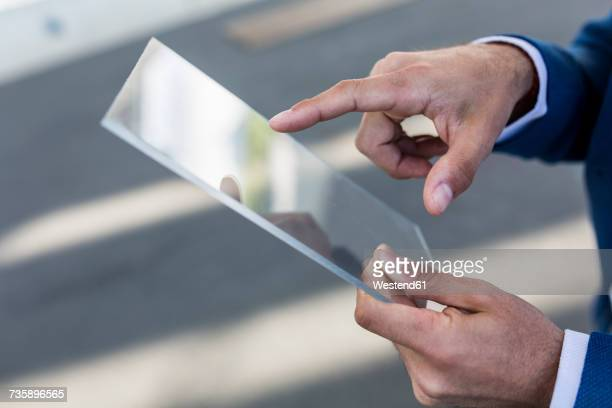 Close-up of businessman using futuristic portable device