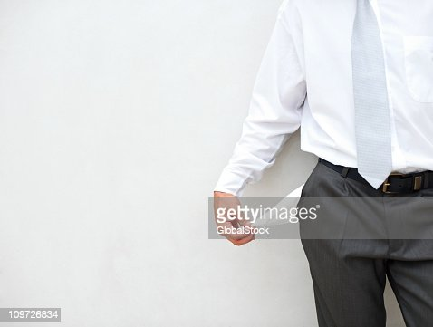 Close-up of businessman with pocket out