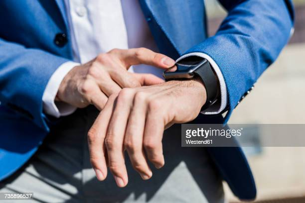 Close-up of businessman with smartwatch